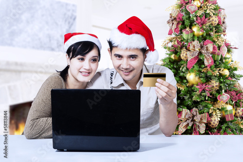 Christmas couple shopping online at home