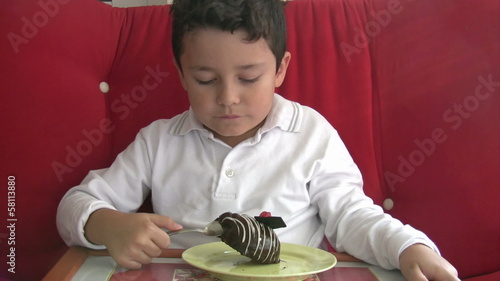 child eating cake and smiling to camera
