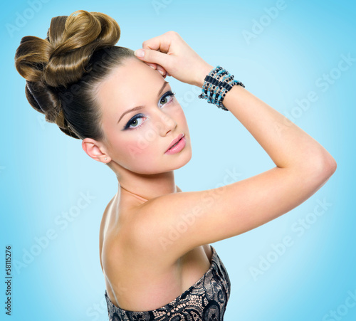 Beautiful teen girl with modern hairstyle