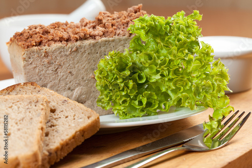 Venison pate on a plate decorated with salad.