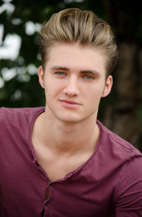 Handsome blond young man head-shot outside