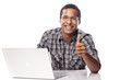 African  man working on his laptop and showing thumbs up