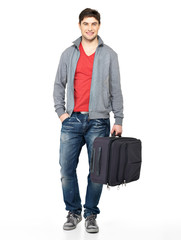 Full portrait of smiling happy man with suitcase