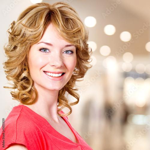 Closeup portrait of happy blond woman