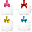 White paper gift cards with color satin bows.