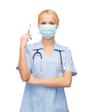 female doctor or nurse in mask holding syringe
