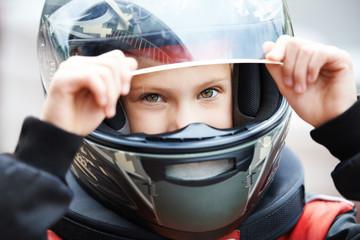 Portrait of a young racer in helmet