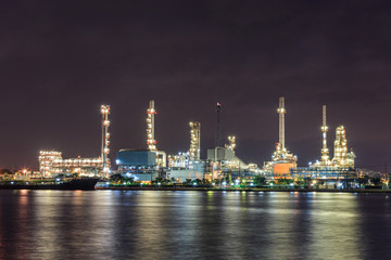 oil industry with river night light