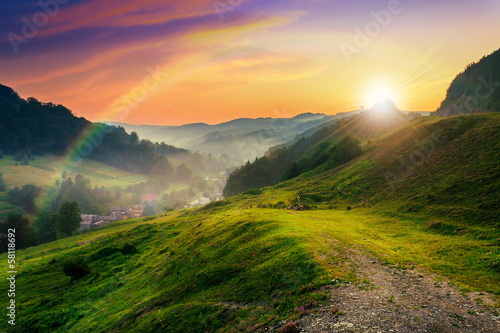 canvas print picture hillside near the village in morning mist