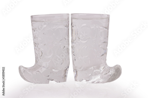 a shot of vodka in a glass slipper on a white background