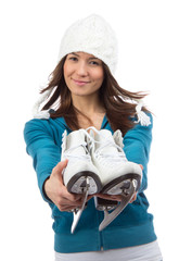 Young woman showing ice skates for winter ice skating