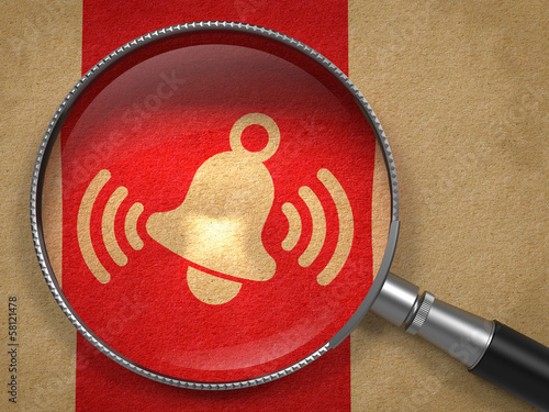 Magnifying Glass with Ringing Bell Icon .