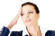 Attractive businesswoman with headache.