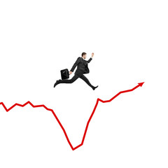 businessman jumping on graph
