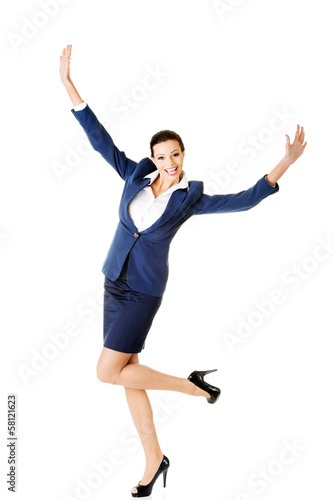 Attractive businesswoman with hands up. Cheerful.