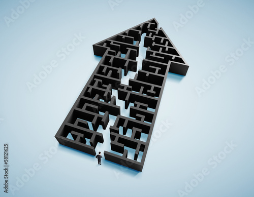 businessman and arrow form labyrinth