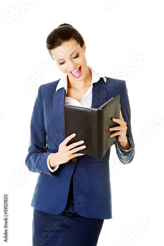 Attractive woman holding a book.