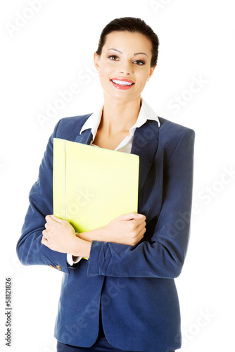 Attractive woman holding files.