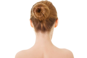 Naked woman's back- head and shoulders.