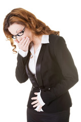 Business woman holding her stomach and covering mouth.
