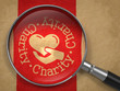 Magnifying Glass with Charity Concept.