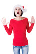 Attractive young woman looking up, wearing santa hat. open hands