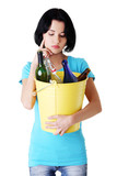 Attractive woman with bottles, recycling idea.