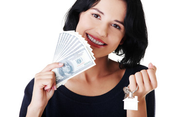 Attractive girl with money and house on hands.