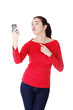 Attractive casual woman with cellphone.