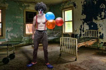 Evil Clown Inside Condemned Room With Hospital Bed