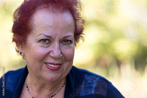 Senior Woman Looking at You Trustfully and Determined