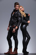 couple in leather clothes standing back to back