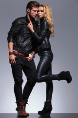 couple dressed in leather clothes in a fashion pose