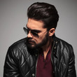 profile of a young man in sunglasses and leather jacket