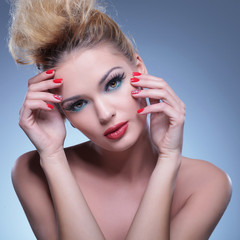classic pose of a beauty woman with hands on face