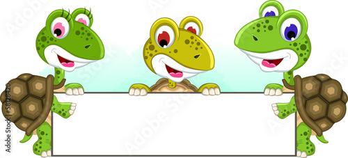 cute turtle cartoon holding balnk sign together