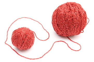Closeup of red small and big wool ball. White background