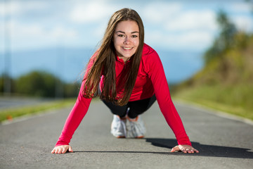 Young woman doing press-up
