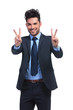smiling business man making the victory hand gesture