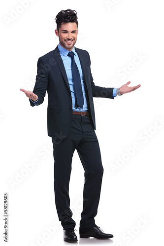 full body picture of a young business man welcoming