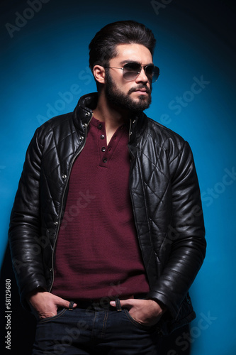 side view profile of a young bearded fashion man in leather jack