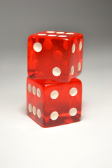 Two Red Dice on top of another