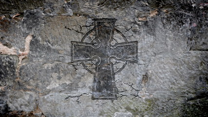Celtic cross in a stone wall