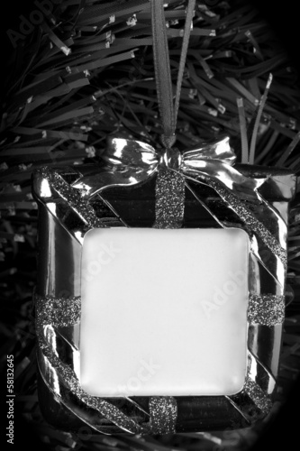 Black and white,hanging photo frame on christmas tree background