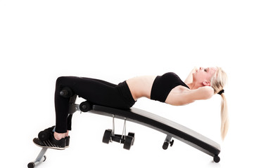 sports girl doing exercises on a press