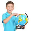 Smiling boy in casual  holding globe