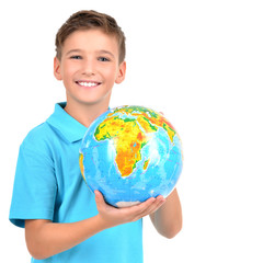 Smiling boy in casual  holding globe in hands