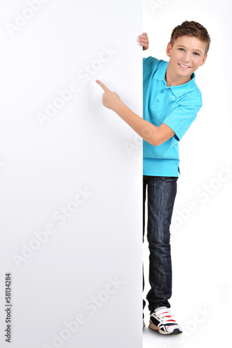 Full portrait of  boy pointing on white banner