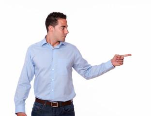 Hispanic man pointing to his left