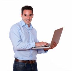 Charismatic male using his laptop computer